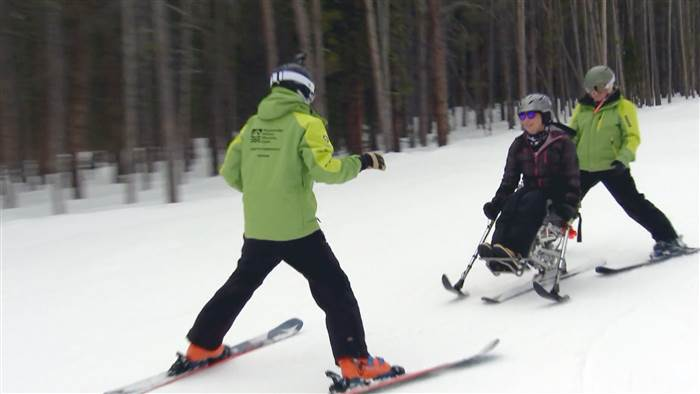 amy van dyken-rouen skiing using adaptive sport skis in Colorado