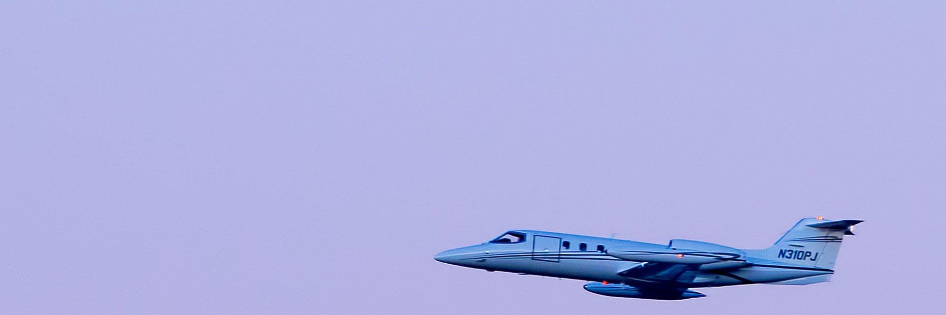 Medically configured air ambulance learjet flying in the sky